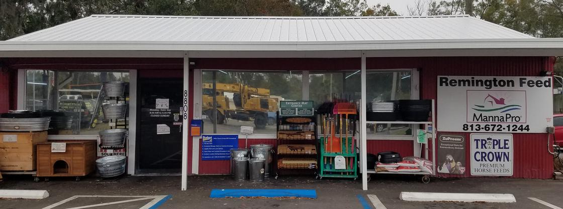 Remington Specialty Feed,Store Front with Product out front, address is 8808 US Highway 301 South, Riverview, Florida8