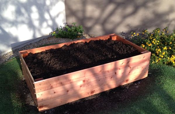 "RAISED BED GARDEN 6' x 3 x 15"" deep 27 cu. ft. capacity $235.00 ​(Designed to site on soil or gravel)"