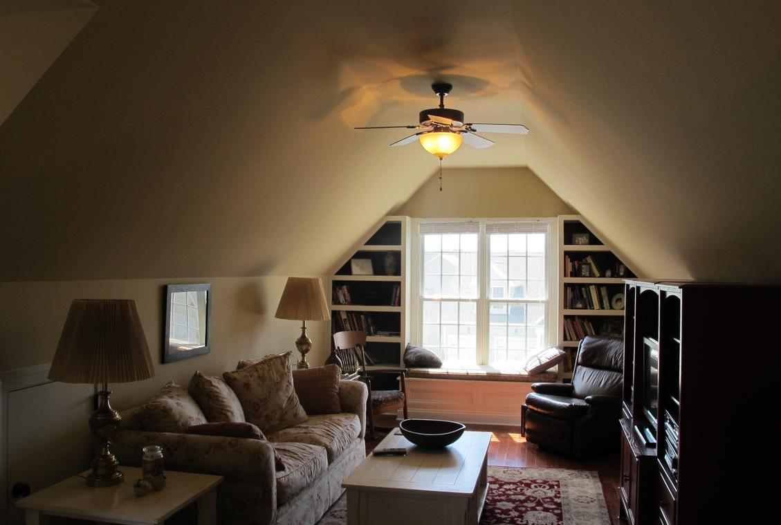 Vaulted ceilings in family room in attic remodel.