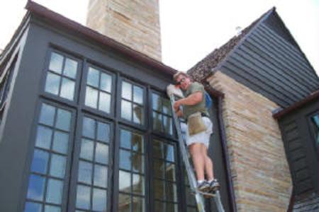 window washer on ladder french windows cleaning tulsa bartlesville