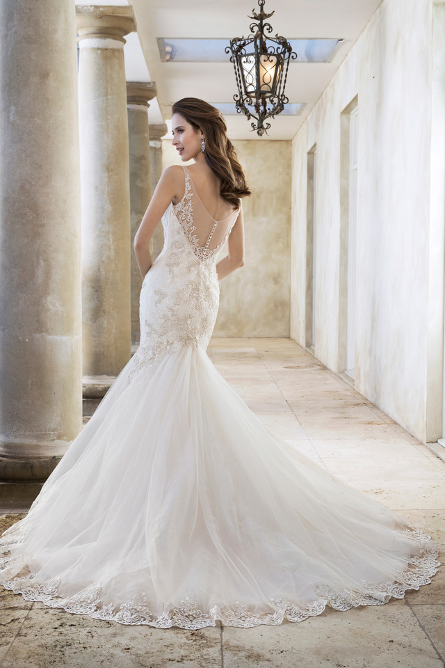 09e7ad6b523  Misty tulle and fantasy organza gown with fit and flare silhouette. Deep-V illusion  neckline with sheer straps and a low back illusion.