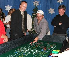 Guests playing craps at a Nashville Holiday Casino Party