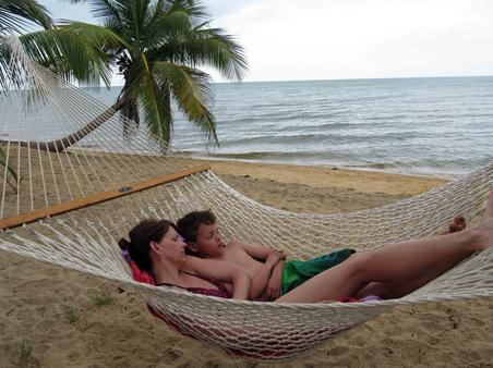 This could be you relaxing in a hammock on your Caribbean vacation in Belize.