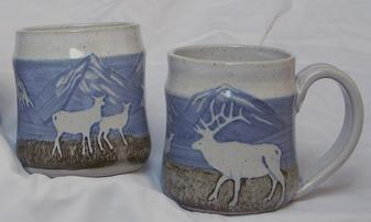 Hand thrown and glazed scenic mugs