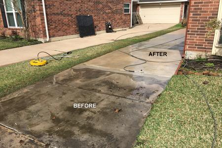 In Houston TX pressure washing a driveway.