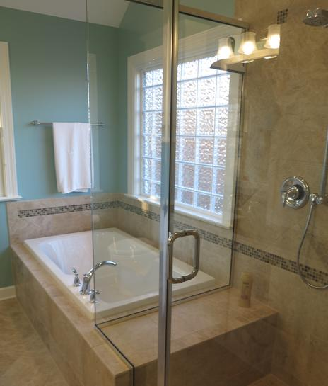 New bathtub and semi frameless glass shower stall are some of the items in this bathroom renovation