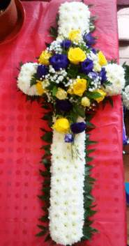 Funeral cross with yellow roses and purple lisianthus The Little Flower Shop Florist London