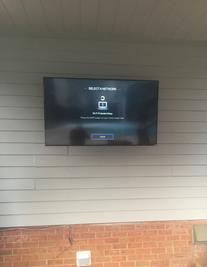 4k ultra HD TV mounted out doors on patio, Charlotte NC Flat Screen TV Wall Mount serves and installation