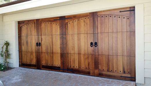 Wood doors custom wood garage doors carriage style for Cedar wood garage doors price
