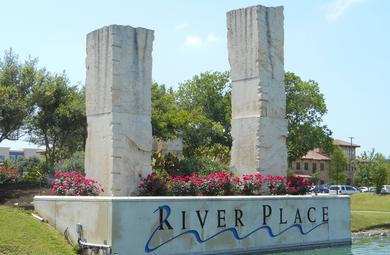 Picture of River Place Sign at the entrance of the community