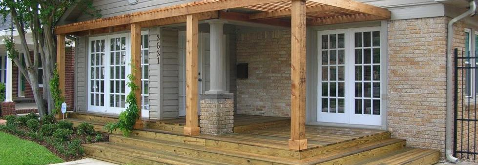 Pergola on deck blocks as a front porch.
