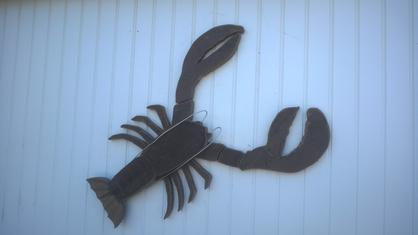 DIY Fence Fish made from recycled Trex. Make your own nauctcal or beach decore fence art. www.DIYeasycrafts.com