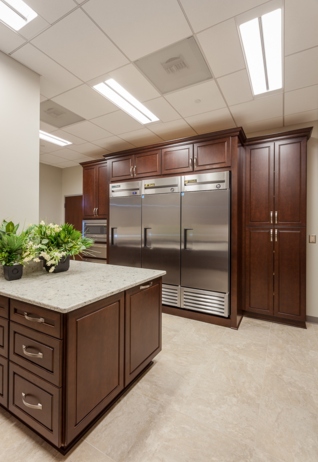 Cherry cabinet; tile flooring; commercial appliances; quartz countertops