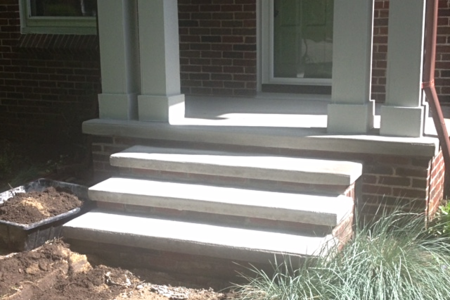 Home brick porch was covered over in cement. Steps were poured to make a beautiful entrance way.