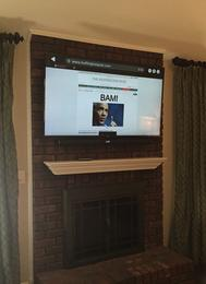 flat screen tv mounted on unwired brick fireplace in charlotte nc, tv on fireplace, tv installers