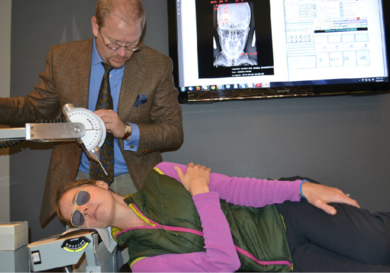 TMJ Specialist, Dr. Chapman painlessly repositions a patient's atlas at his clinic in Provo, Utah