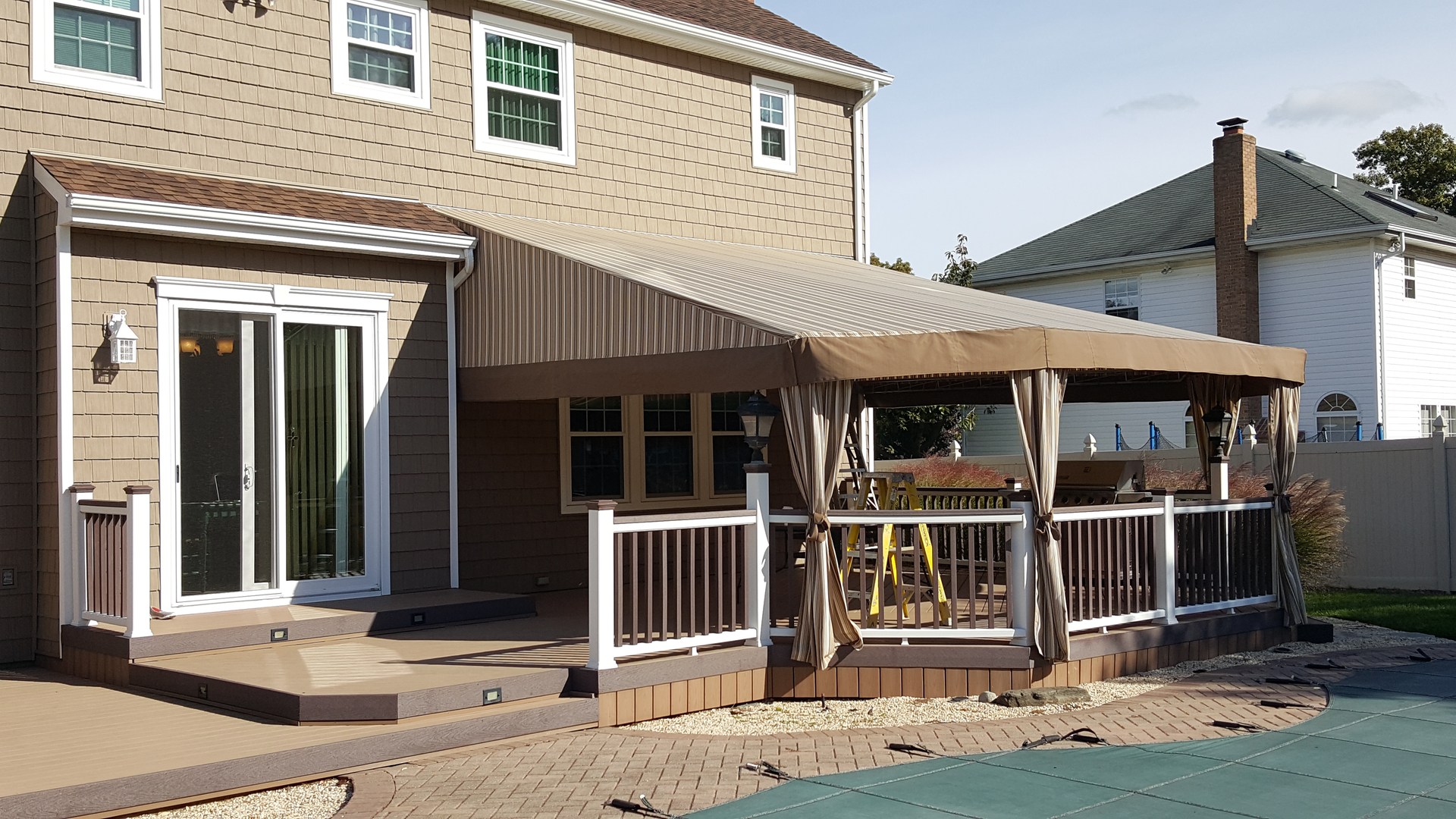 awnings ca long awning dome by and white county black stripped orange the company island