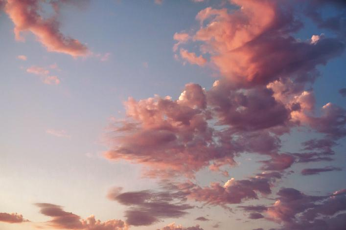 beautiful pink sunset clouds over blue sky