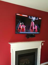 flat screen tv mounted over fireplace wiith floating glass shelf installed below.  TV installers, plasma tv mounting,