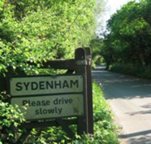 Picture of gate and sign at the entrance to Sydenham Village