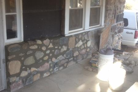 Stone work at an Ann Arbor home. Stones were removed and relaid with bew grouting.