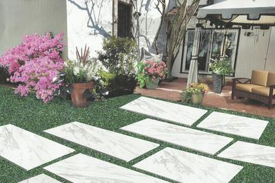 San Antonio Landscape Design with a beautiful mulched bed and a custom designed stone path with a porch and an awning