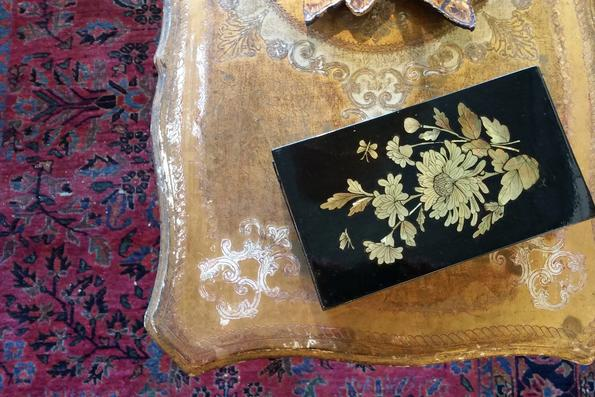 antique chinoissier talbe box on florentine gesso vintage table on persian vegetable dye carpet
