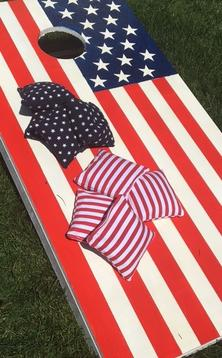 "How to easily make a Patriotic themed Red, White and Blue Corn Hole ""Bags"" Yard game board. FREE step by step instructions www.DIYeasycrafts.com"