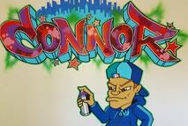 Connor graffiti mural in a bedroom in spray paint