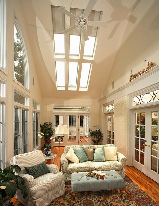 Sunroom with 12 skylights and heart pine flooring.