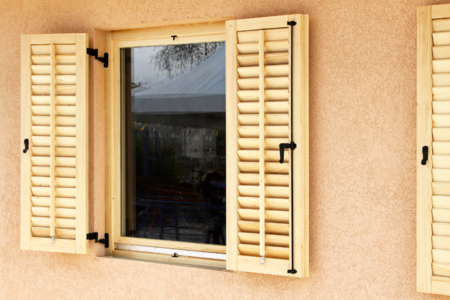 natural wood colored exterior shutters in a home's front windows