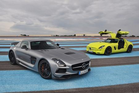 do you see that bright green sls in the background well its actually not an sls its an sls electric drive the grey car is the sls black series