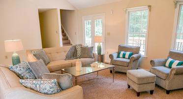 This vacant home staging package included a full suite of living room furniture to make the large space feel warm.