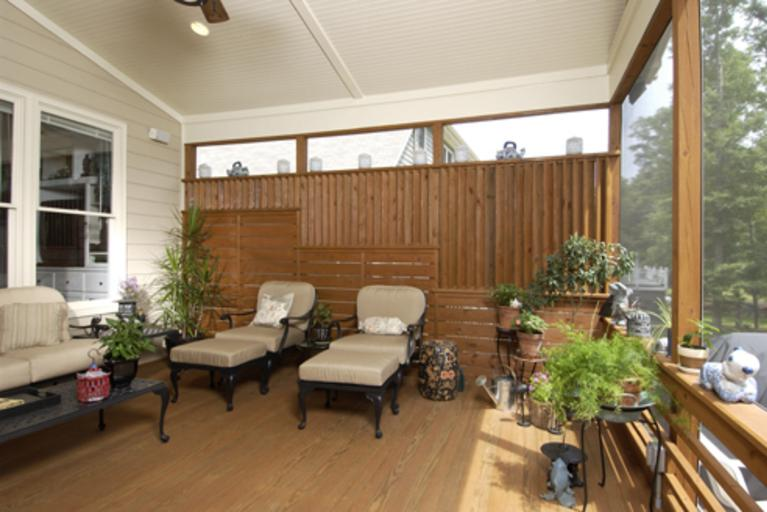 Screened porch and dining room addition with custom privacy panels