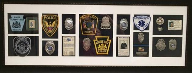 Laird Cole Patch and Badge Display from previous agencies he was associated with.