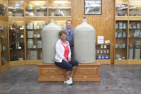 Tammy And Burley Green Presenting Personally Handcrafted Bases To Highlight 60 Gallon Jugs In The Red Wing Museum