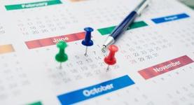 Stock photo of generic calendar with pushpins