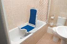 bathtub lift in bathtub with comfort height toilet and pedestal sink