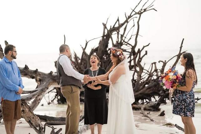 rainy beach wedding. Officiant fun