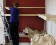 Pupil putting up personalised shelves in their bedroom