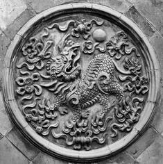 Traditional Tai CHi's dragon medallion.