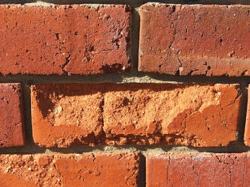 Damaged brick from tuckpointing