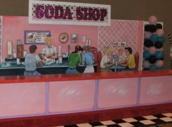 50's Themed Decor-Soda Shop Counter with Balloon Decor and Themed Props.