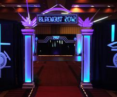 "Dramatic Glow-in-the-Dark Event Decor for a ""Blackout"" Themed Prom."