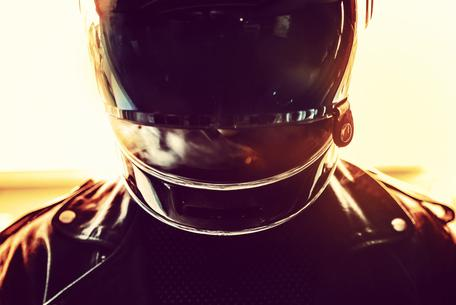 badass smoking biker leather jacket and helmet