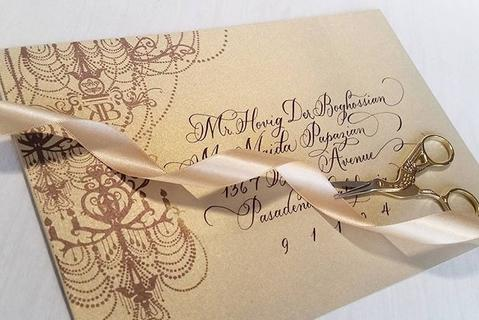 Copperplate calligraphy on envelopes for wedding invitations.