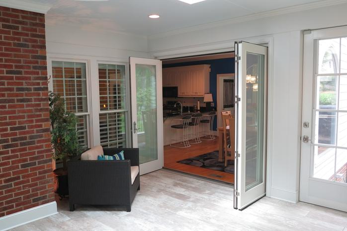 Andersen folding door helps inside and outside blend seamlessly.