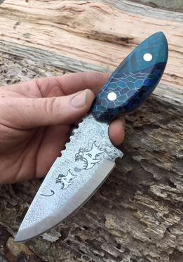 Berg Knife Making custom etched fish eating fish themed knife. www.Bergknifemaking.com