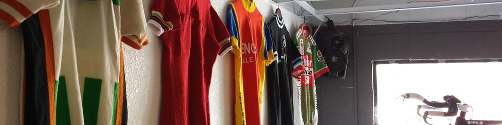 Vintage bike jerseys hanging on the wall at Boulder Bicycle Works