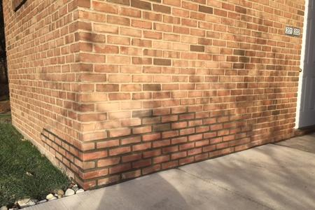 The corner of an Ann Arbor home had cracks in the bricks. Grammatico Masonry repaired by replacing some bricks and doing tuckpointing repairs.